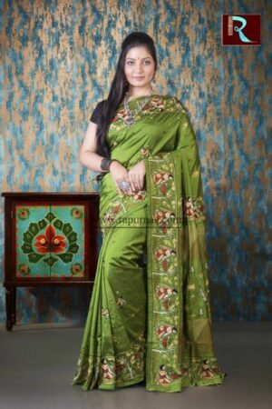 Hand Ari work on Art Silk Saree of Pesta Green color