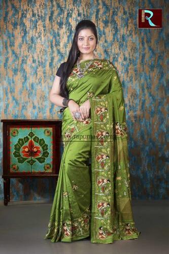 Hand Ari work on Art Silk Saree of Pesta Green color